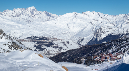 Scenic view of the popular ski resort Les Arcs in French Savoy Alps. Snowy mountains on a sunny day