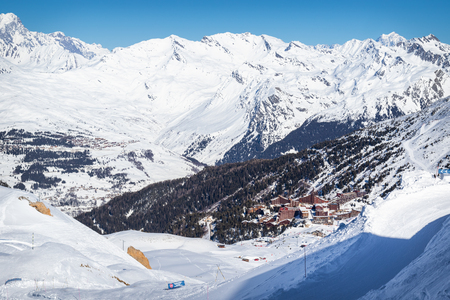 Scenic view of the popular ski resort Les Arcs in French Alps. Beautiful sunny day with blue sky and snowy mountains
