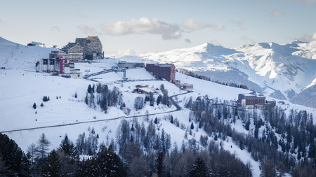 View of La Plagne Aime 2000 ski resort in French Savoy Alps. Snow covered mountains and buildings of ski apartments Imagens