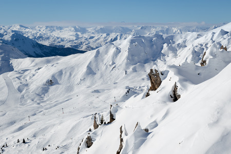 Beautiful view of snow covered rocks and mountains in the alpine ski resort La Plagne, France