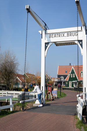 Marken, Netherlands - April 7, 2019: View of the Beatrix drawbridge in the picturesque village of Marken in Waterland
