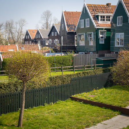 Marken - picturesque green wooden houses by canal in the Dutch island and village Marken 写真素材