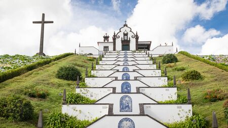 Chapel Nossa Senhora da Paz (Our Lady of Peace) by town Vila Franca do Campo, Sao Miguel island in Azores. Beautiful and popular religious site visited by local people and tourists. 写真素材