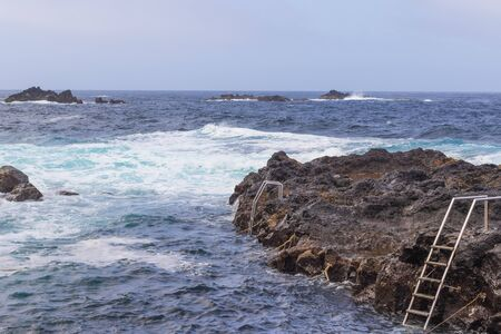 Natural volcanic rocks near Ponta da Ferraria, the place where hot springs mix with seawater in  Sao Miguel island, Azores, Portugal Standard-Bild