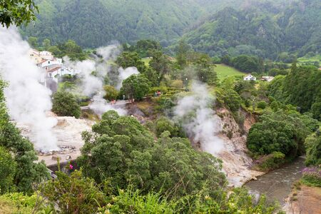 View of steam venting from hot springs in the thermal park in the small town Furnas, Sao Miguel island in Azores, Portugal Stock fotó