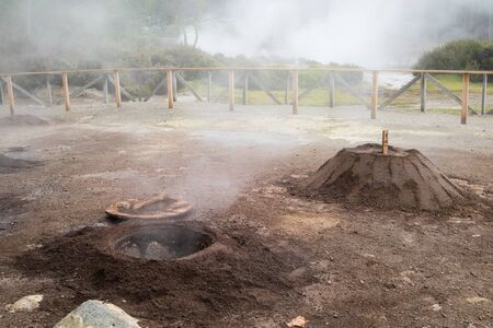 Geothermal cooking - a hole where traditional meal Cozido das Furnas is cooked slowly in a hot spring by volcanic steam in Furnas on Sao Miguel, Azores, Portugal 写真素材 - 129899591