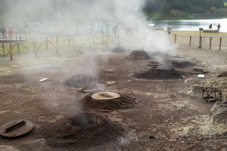 Geothermal cooking - holes where traditional meal Cozido das Furnas is cooked slowly in a hot spring by volcanic steam in Furnas on Sao Miguel, Azores, Portugal 写真素材