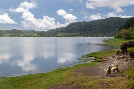 Scenic view of Furnas lake in Sano Miguel island, Azores, Portugal. An enchanting and tranquil scene of lush foliage and the lake in a volcanic crater