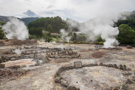 Boiling water and hot steam venting from Caldeira Grande (Big boiler) in small town Furnas, Sao Miguel island in Azores, Portugal