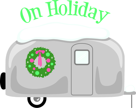 coronal: RV enthusiasts will like this snow-covered travel trailer with a Christmas wreath.