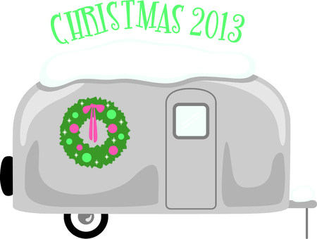 snowcovered: RV enthusiasts will like this snow-covered travel trailer with a Christmas wreath.