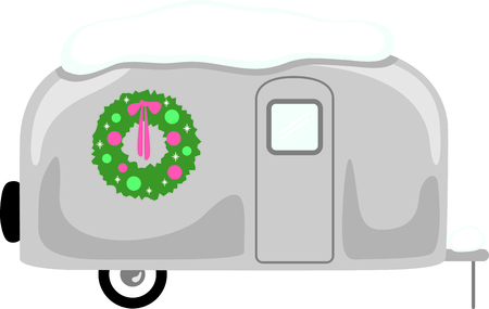 rv: RV enthusiasts will like this snow-covered travel trailer with a Christmas wreath.