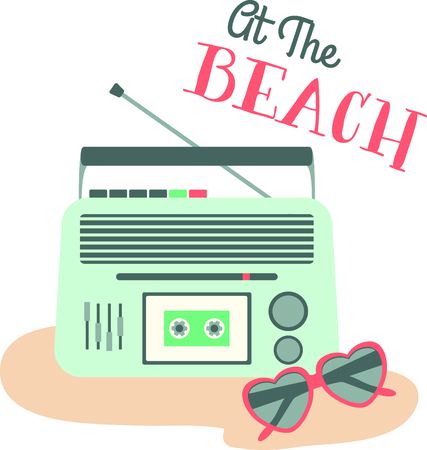Retro cassette player and heart-shaped shades on the beach.