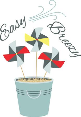 pinwheels: Bucket of pinwheels in the sand.