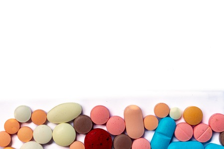 Drugs consumed orally. Colorful pills on a white background Stockfoto
