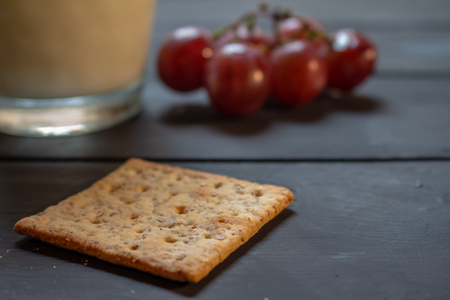 Breakfast with wholemeal cookies, fruits and drink on a rustic background. Natural breakfast