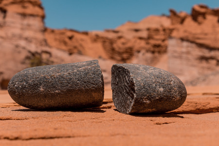 Boulder stone split in the middle by the temperature. Mountainous desert landscape. Stok Fotoğraf