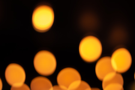 Lines formed by blurred lights of golden colors. Resource for designers. Rounded lights of warm colors. Holiday lights Imagens