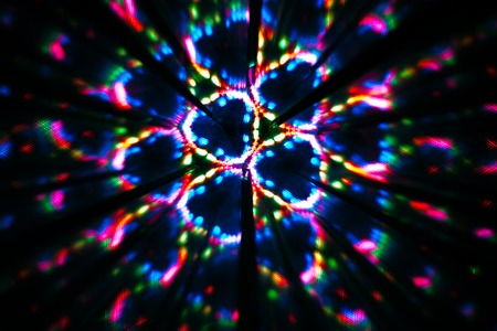 Abstract image of circular shape made with a kaleidoscope. Reflection of lights that generates images of fractal type.