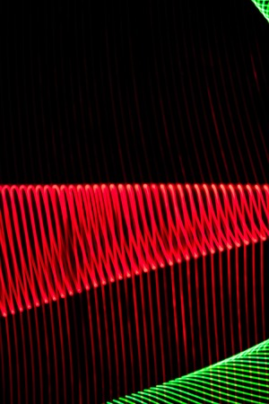 Abstract colorful lines on black background. Patterns of lines forming colorful figures. 版權商用圖片