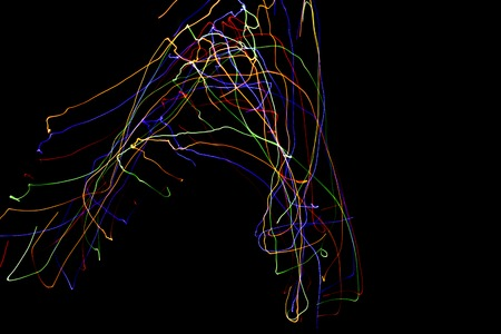 Abstract colorful lines on black background. Light painting photography. Lights with irregular patterns for overlay. Resource for designers.