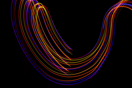 3d illustration. Abstract lines of light painting of reddish colors on black background. Abstract three-dimensional patterns.