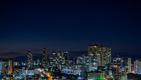 Night view of a city with countless buildings very close to each other. Stok Fotoğraf