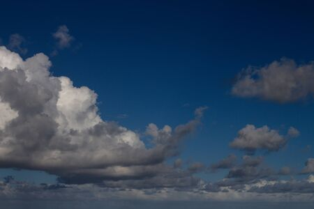 Storm clouds. Water in the form of steam in the sky. Cumulus in the sky.