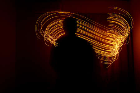 Abstract light painting on black background. Circular holiday patterns. Imagens