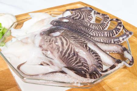 tentacles: Tent�culos del calamar fresco Foto de archivo