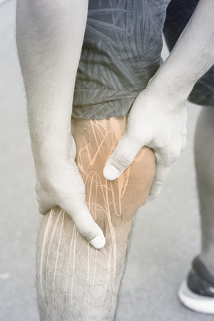 brawn: Knee muscle pain Stock Photo