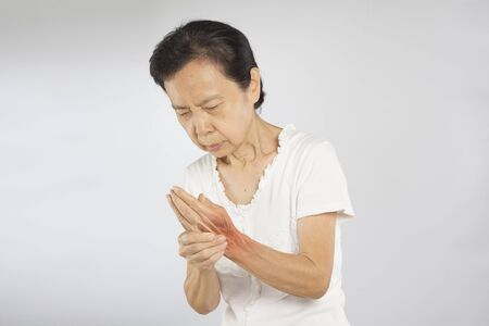 old asian woman hand muscle pain