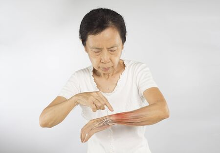 old asian woman feel wrist muscle injury