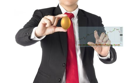 business man invest in gold egg , concept risk investment in trading asset