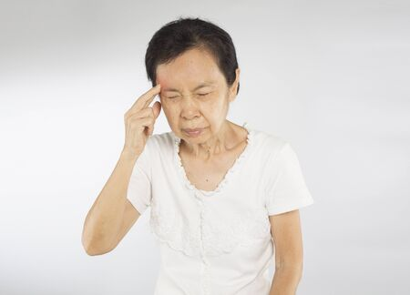 old asian woman arms raised touch her head feel headache migraine Stock fotó - 137053385