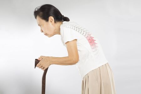 old asian woman stand feel spine bones pain