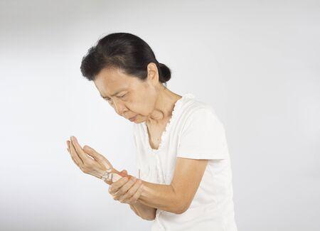 old asian woman feel wrist bones injury Stock fotó - 137334345