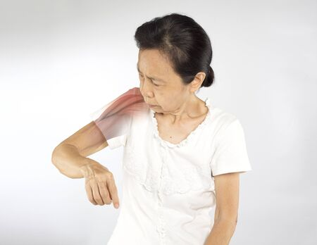 old asian woman feel shoulder muscle injury Imagens
