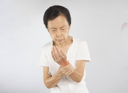 old asian woman feel wrist muscle injury Stock fotó - 137654457