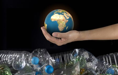 hand hold plastic bottles to discard ,concept global warming Stock fotó - 138153611