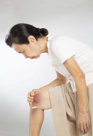 old asian woman touch knee muscle pain