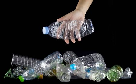 hand hold plastic bottles to discard ,concept global warming