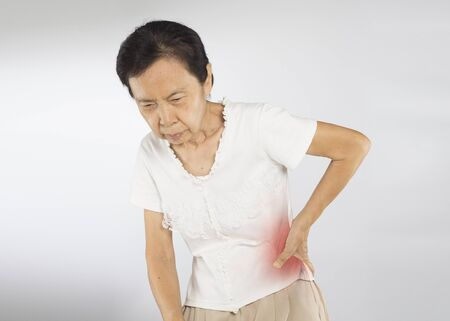 old asian woman feel spine muscle pain
