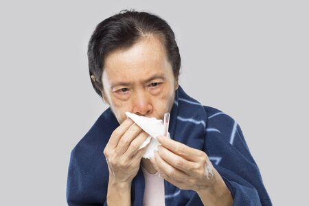 old asian woman feel have fever and sick