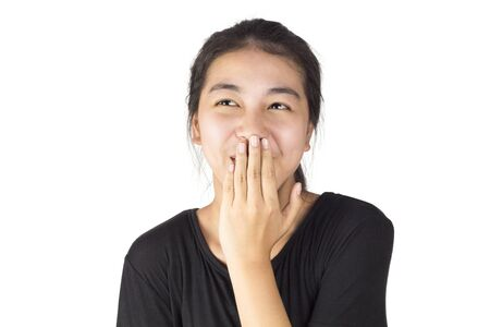 Asian woman bring one hand to cover the mouth and emotion laugh 版權商用圖片