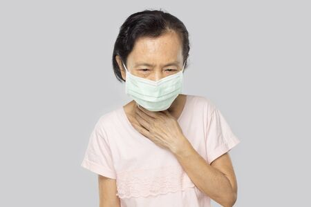 old asian woman feel sore throat have fever and sick Stock fotó