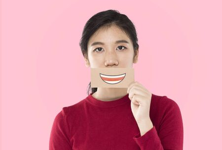 young asian woman holding happy emotion paper , advertising banner