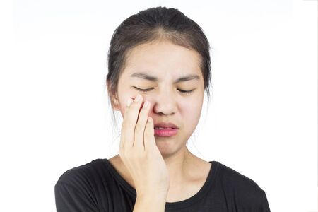 Women feel toothache due to tooth decay
