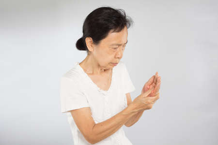 old asian woman feel hand muscle injury