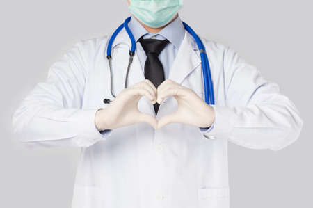 doctor held his hand to mark love in gray background